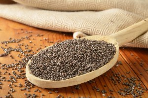 Organic chia seeds in a wooden spoon.  Shallow depth of field, focus in center area of spoon