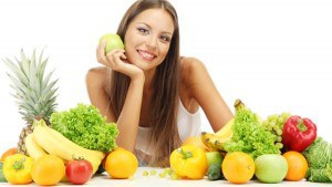 Woman-surrounded-by-fruits