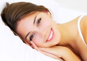 sleeping-woman-bed-smile