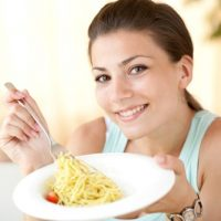 woman-eating-pasta-for-breakfast